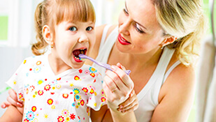Here Is Why And How To Brush For Your Kids